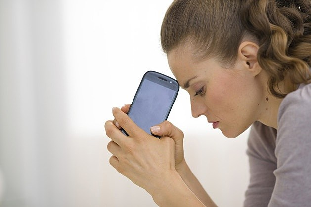 Cellphone stressed woman